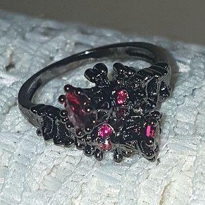 Garnet crowned skulls ring, really cool! Size 6